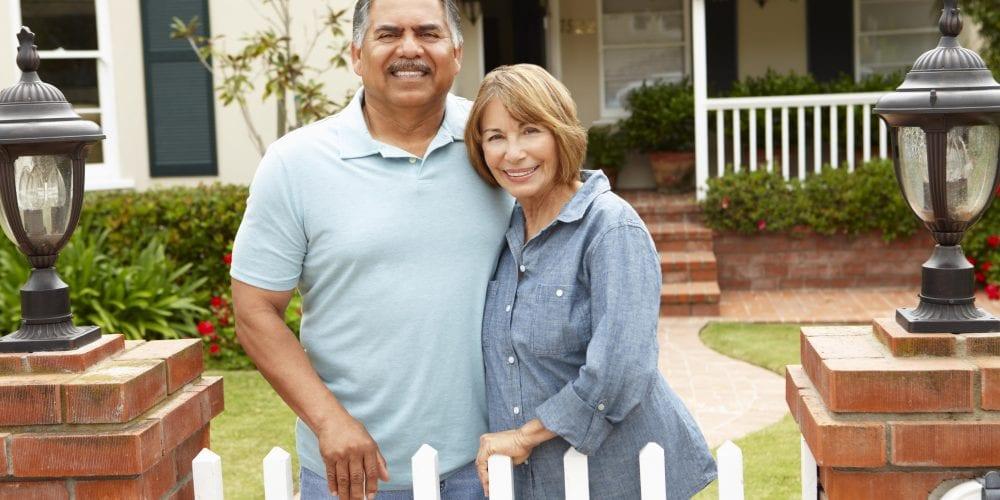 depositphotos 11884427 stock photo senior hispanic couple outside home