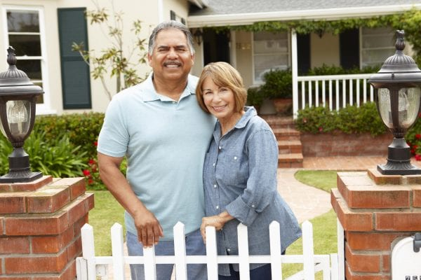 depositphotos 11884427 stock photo senior hispanic couple outside home