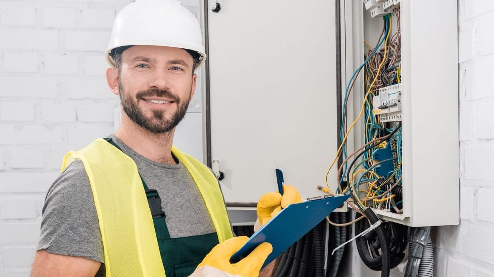 electrician fixing wiring box mobile
